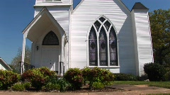 The white clapboard exterior of an old country church Stock Footage