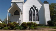 Stock Video Footage of The white clapboard exterior of an old country church
