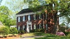 A beautiful, Georgian Colonial house surrounded by trees Stock Footage