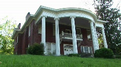 Massive, stately columns of a Classical Revival Style home Stock Footage