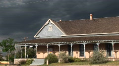 Medium-shot of a ranch house with storm clouds building behind Stock Footage