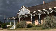 Medium-shot of a ranch house as storm clouds gather behind it Stock Footage