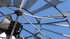 Close-up of the blades of a windmill spinning - stock footage