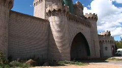 Pan-up of the front gate of a medieval castle Stock Footage