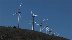 Medium shot of wind turbines generating power Stock Footage