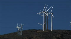 Wind turbines generating power in Tehachapi, California Stock Footage