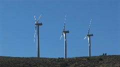 Three wind turbines generating power at Tehachapi, California Stock Footage