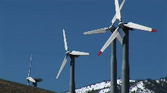 Four wind turbines generating power at Tehachapi, California Stock Footage