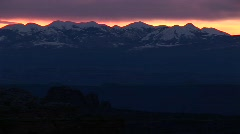 Long-shot of the La Sal Mountains silhouetted at golden-hour Stock Footage