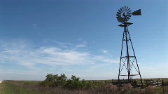 Medium shot of a windmill turning in the breeze Stock Footage