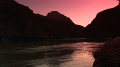 Long shot of the Colorado River flowing through the Grand Canyon Stock Footage