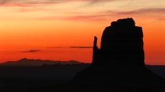 Rock formation silhouetted at golden-hour in the desert southwest Stock Footage