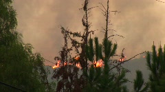 Wildfires burning on the top of a ridge in Southern California - stock footage
