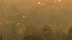 Pan-up shot of fires raging near a Southern California community Stock Footage