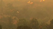 Stock Video Footage of Pan-up shot of fires raging near a Southern California community