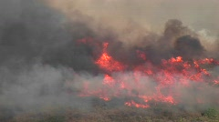 Long-shot of smoky wildfires burning in southern California Stock Footage