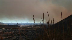 Long shot of the smoke from wildfires covering Ventura, California Stock Footage