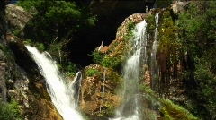 Medium-shot of waterfalls flowing into a pool in Big Sur, California Stock Footage