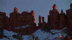 Rock formations in Bryce Canyon National Park dusted in snow Stock Footage