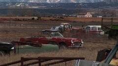 Rusting automobiles in a Colorado boneyard Stock Footage