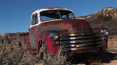 Wide shot of rusted old pickup truck littering the Utah desert Stock Footage