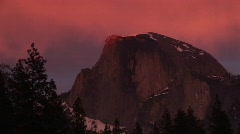 Medium wide shot of Yosemite's Half Dome in winter golden-hour Stock Footage