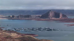 Wide shot above Lake Powell, Arizona with boat docks in foreground Stock Footage