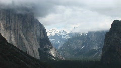 Medium-shot of Yosemite Valley cloaked in low-hanging clouds Stock Footage
