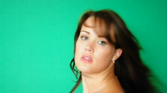 HD720p Young sexy brunnete woman looking on green background (greenbox) Stock Footage