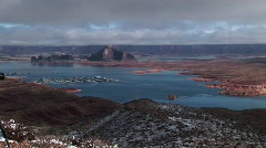 Medium-shot of low clouds hanging over a Lake Powell, Arizona marina Stock Footage