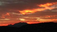 Medium-shot of a fiery sunset over the Santa Barbara Mountains, California Stock Footage