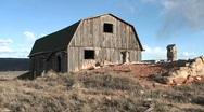 Medium-shot of a weathered, abandoned barn outside Moab, Utah Stock Footage