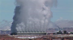 A factory in the Arizona Desert emitting clouds of smoke Stock Footage