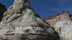 Pan-up a limestone rock formation in a desert canyon Stock Footage
