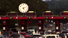 Time-lapse of traffic moving through a tollbooth Stock Footage