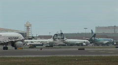 Airplanes taxi along a runway at a large modern airport Stock Footage