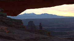 A light sky silhouettes a Mesa in Canyonlands National Park, Utah Stock Footage