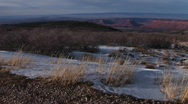 The desert southwest with distant buttes and snow in the foreground Stock Footage