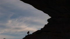A hiker climbs a rocky slope Stock Footage