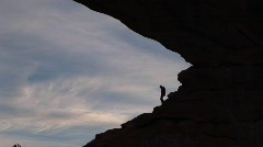A hiker reaches the top of a rocky slope Stock Footage