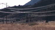 Stock Video Footage of High tension wires reflect the sun