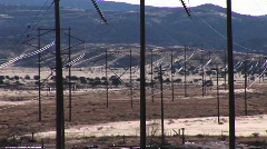 Pan-right across electrical power lines running across a Western landscape Stock Footage