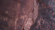 Stock Video Footage of Medium shot of American Indian petroglyph's at Newspaper Rock, Utah