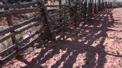 Close-up of an old log fence around an old western corral Stock Footage