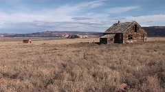 Long shot of an abandoned homestead on a lonely prairie Stock Footage