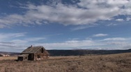 Long shot of an old abandoned homestead on a lonely prairie Stock Footage