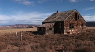 Medium shot of an old abandoned homestead a lonely prairie Stock Footage