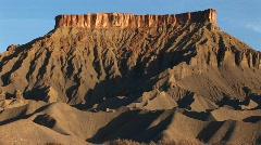 A large butte stands in the Southwest desert Stock Footage