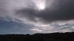 Long shot of sunlight shining through storm clouds Stock Footage
