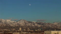 Long shot of Salt Lake City, Utah with the moon rising behind. Stock Footage